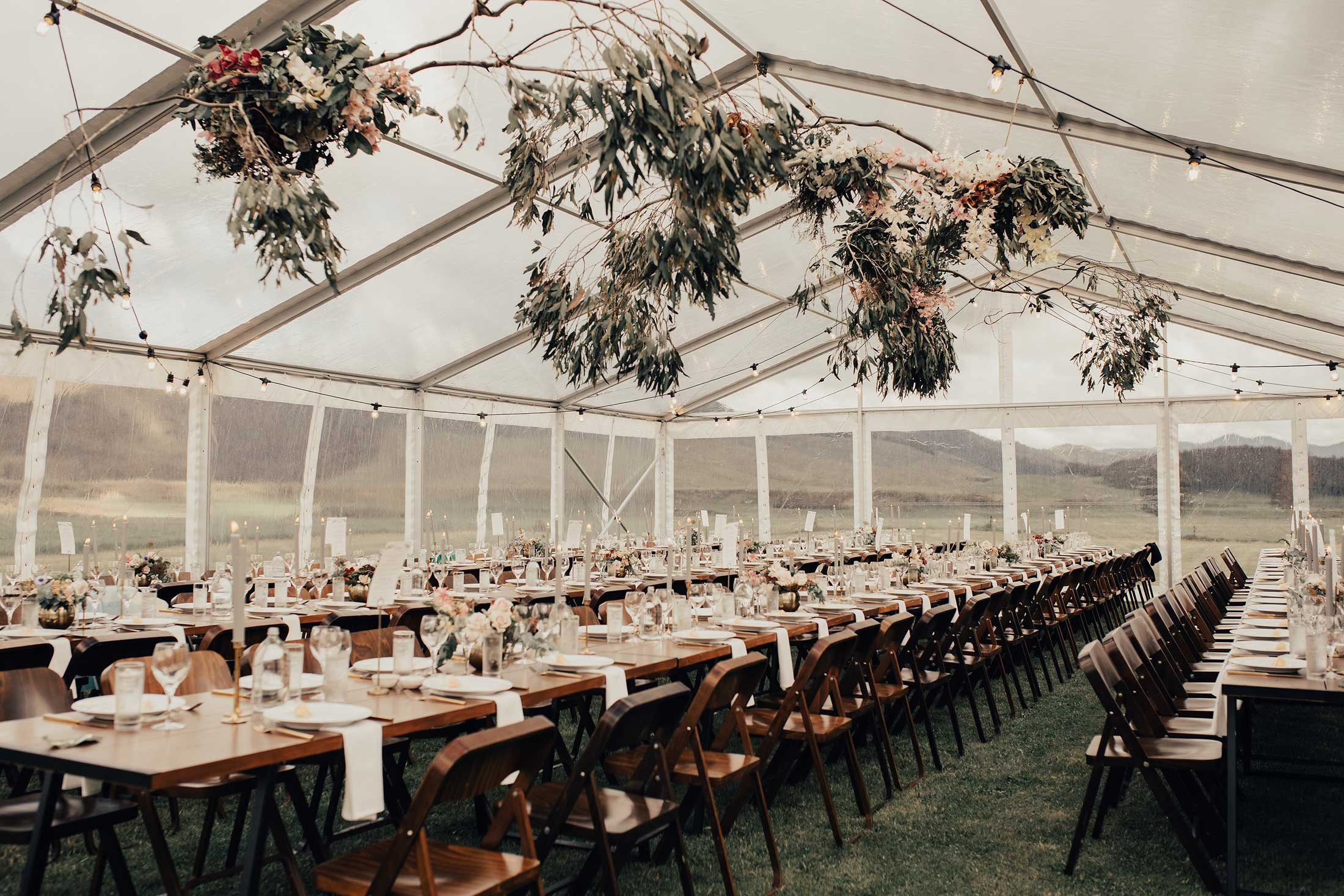 twelve-tables-inside-clear-marquee-hire-new-zealand-inside